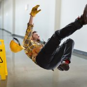 man slipping on wet floor without anti slip coating