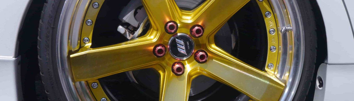 golden Automotive coating refinish applied on a rim