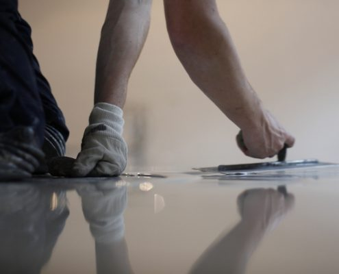 Applying Floor coating qatar