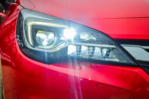 car head light treated with non-reflective coating