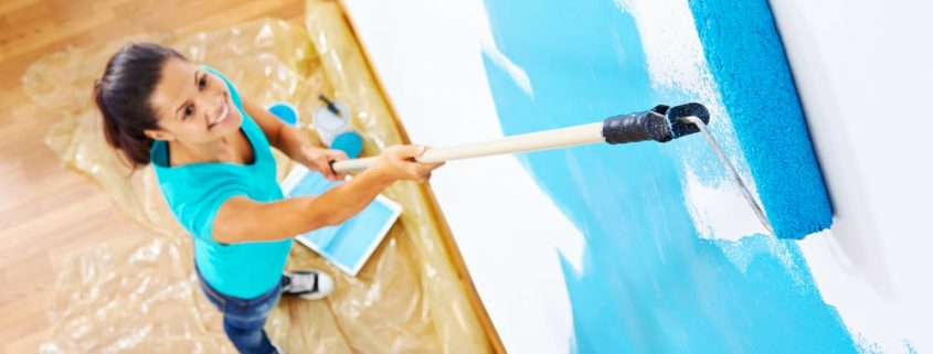 decorative paint being applied on a wall with a roller