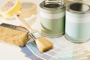 Decorative paint, color charts and brushes in pastel colors