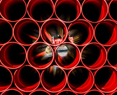 red pipeline coating on metal pipes