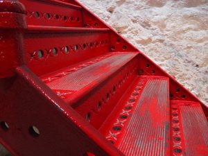 polyurethane paint on red metal stairs
