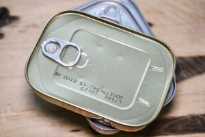 metal food cans treated with packaging coatings for protection